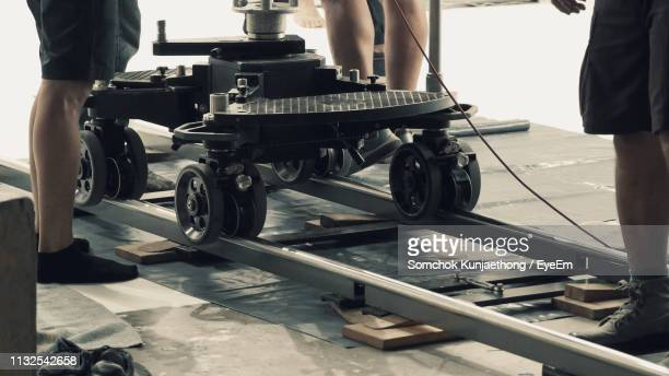 low section of people on dolly track at film studio - film or television studio stock pictures, royalty-free photos & images