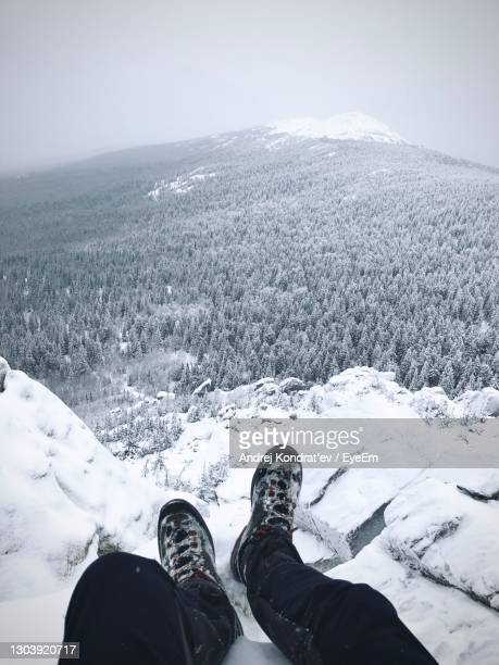 low section of people on snowcapped mountain - human foot stock pictures, royalty-free photos & images