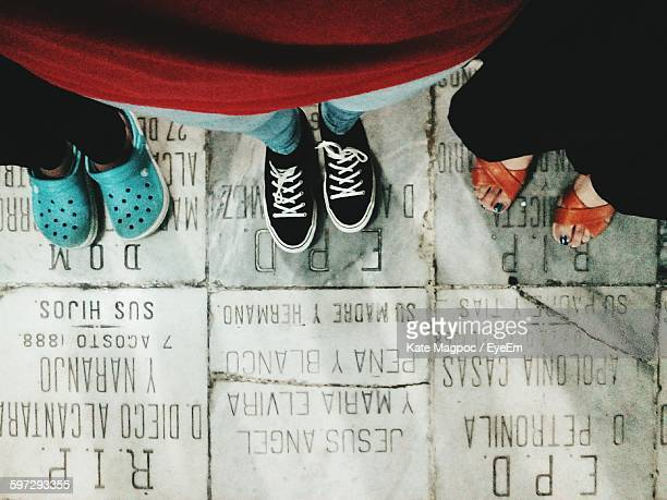 Low Section Of People On Text Written Floor
