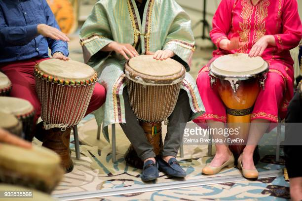 Low Section Of People Playing Djembes