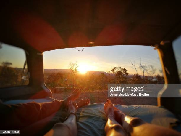 low section of people relaxing in car - lying down stock pictures, royalty-free photos & images