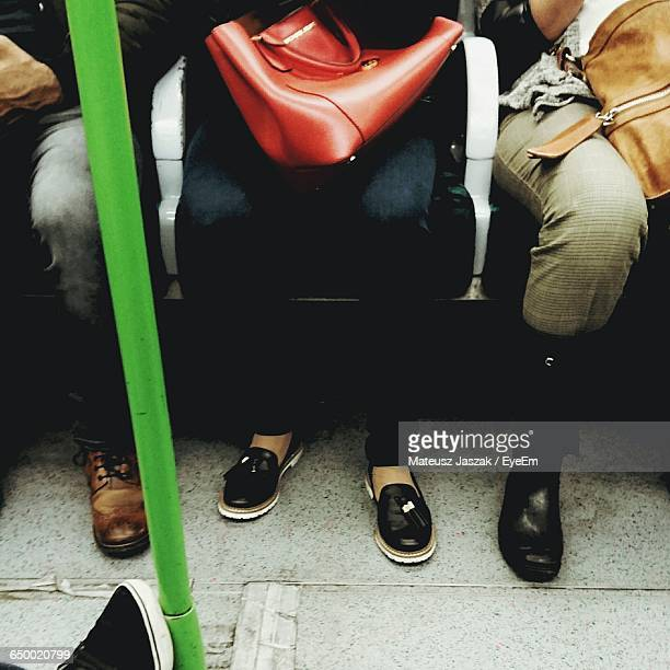 Low Section Of People Sitting In Bus