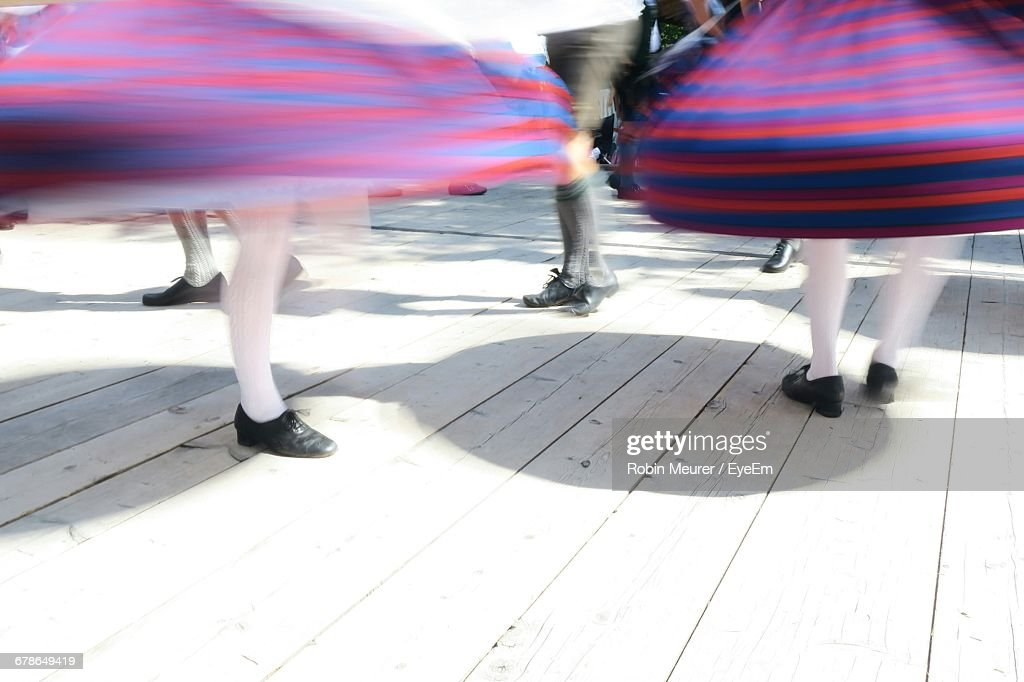 Low Section Of People Spinning On Floor During Waldfest : Stock Photo