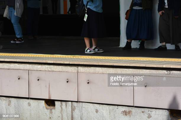 Low Section Of People Standing At Railroad Station - Tokyo Japan