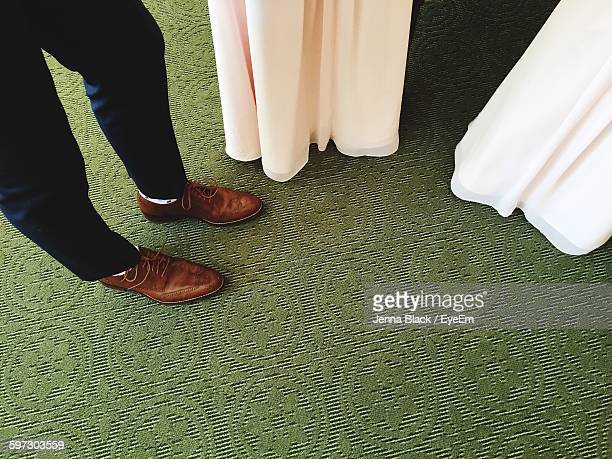 low section of people standing on green carpet - utah wedding stock pictures, royalty-free photos & images