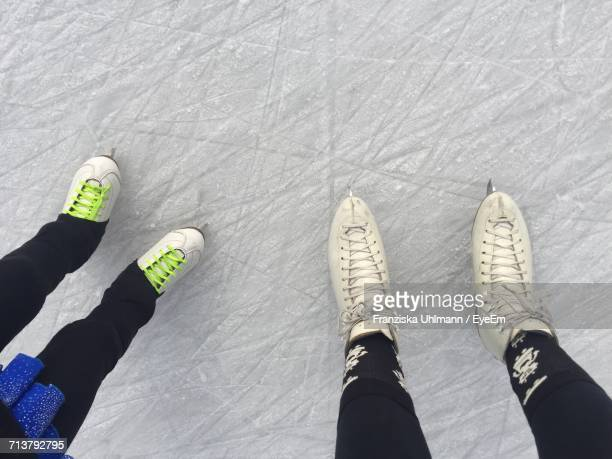 Low Section Of People Standing On Ice Rink