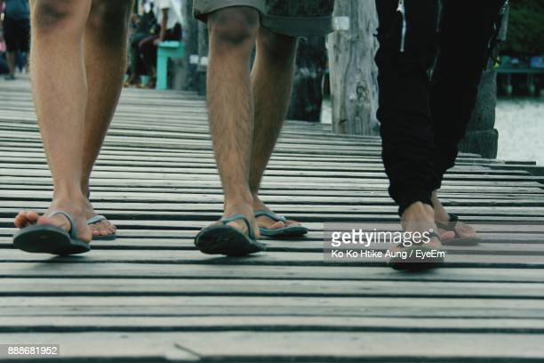 low section of people walking on boardwalk - ko ko htike aung stock pictures, royalty-free photos & images
