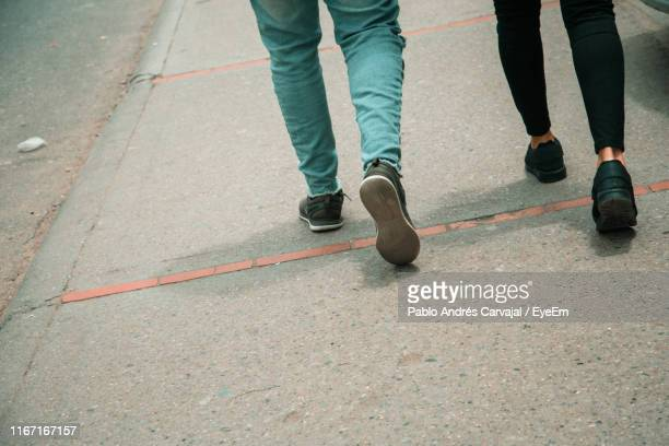 low section of people walking on footpath - carvajal stock photos and pictures