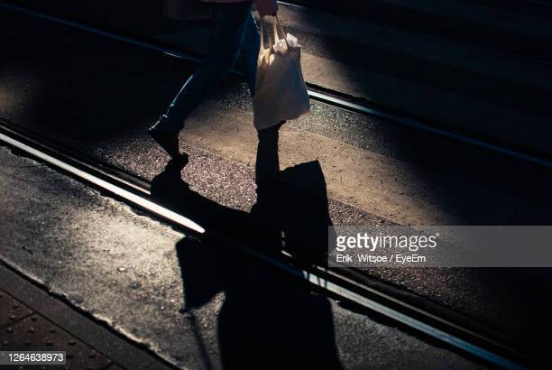 low section of people walking on railway bridge - colors soundtrack stock pictures, royalty-free photos & images