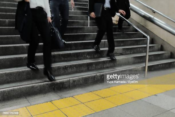 Low Section Of People Walking On Stairs