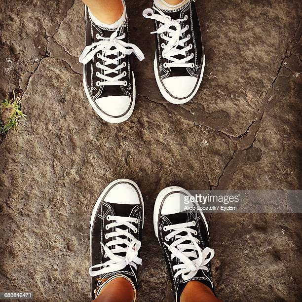 Low Section Of People Wearing Identical Shoes