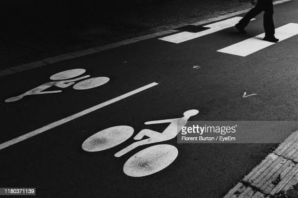 low section of person crossing road at night - france lille stock pictures, royalty-free photos & images