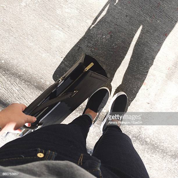 Low Section Of Person Holding Hand Bag