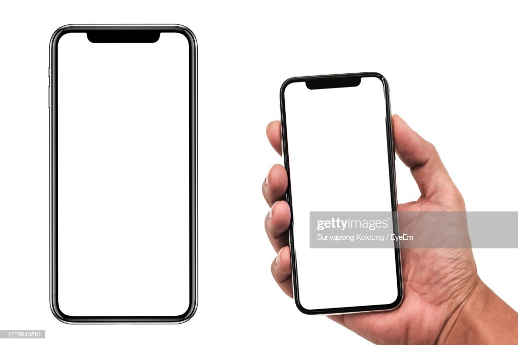 Low Section Of Person Holding Smart Phone Over White Background : Stock Photo