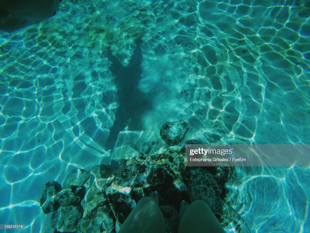 Low Section Of Person In Water : Stock Photo