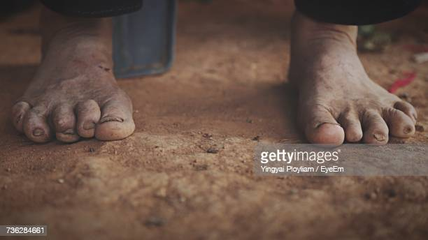Low Section Of Person On Dirt Floor