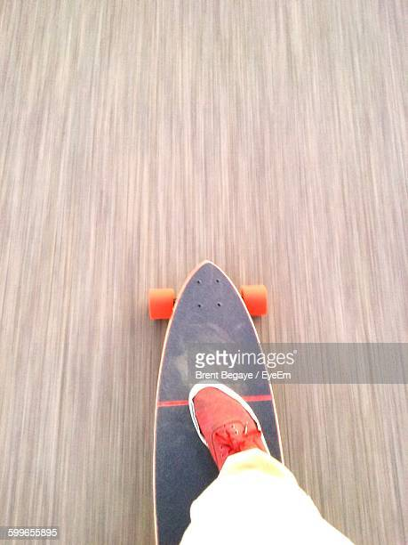 Low Section Of Person On Longboard