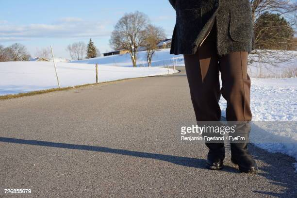 Low Section Of Person On Road During Winter