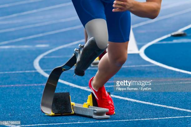 low section of person on running track - conquering adversity stock pictures, royalty-free photos & images
