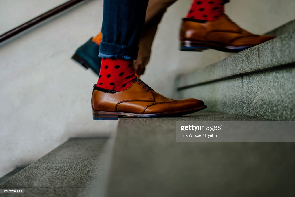Low Section Of Person On Stairs : Stock Photo
