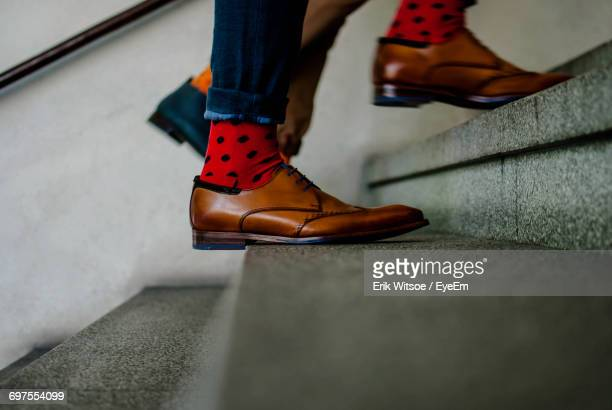 low section of person on stairs - stairs stock photos and pictures