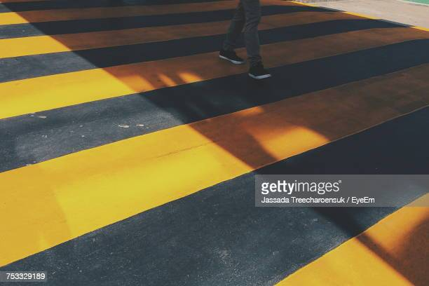 Low Section Of Person On Yellow Zebra Crossing