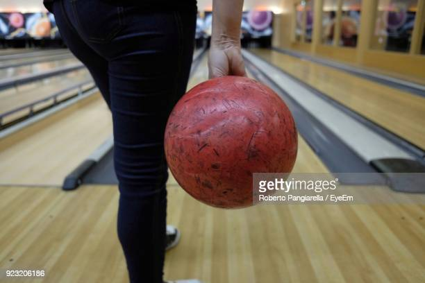 Low Section Of Person Playing Bowling
