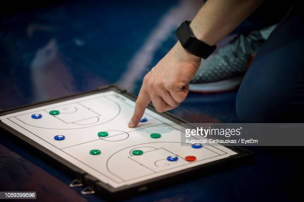 low section of person playing game on floor - cetkauskas stock pictures, royalty-free photos & images