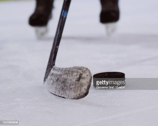 low section of person playing ice hockey - ice hockey stock pictures, royalty-free photos & images