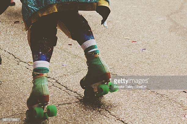 Low Section Of Person Roller Skating On Street