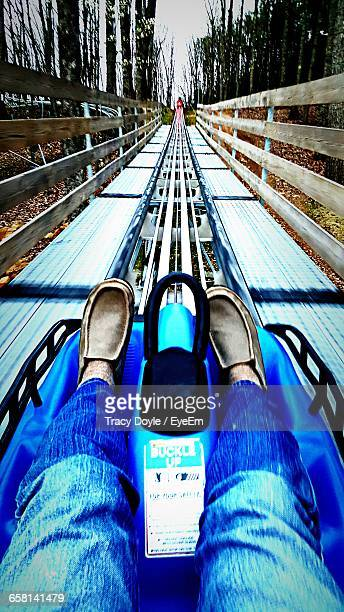 low section of person sitting in amusement park ride - pigeon forge stock pictures, royalty-free photos & images