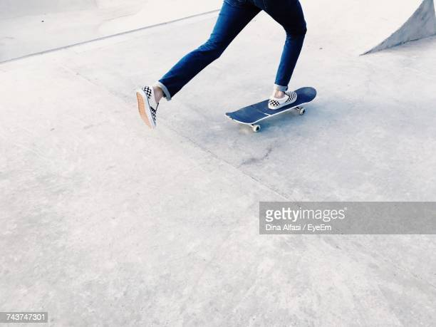 Low Section Of Person Skating At Skateboard Park