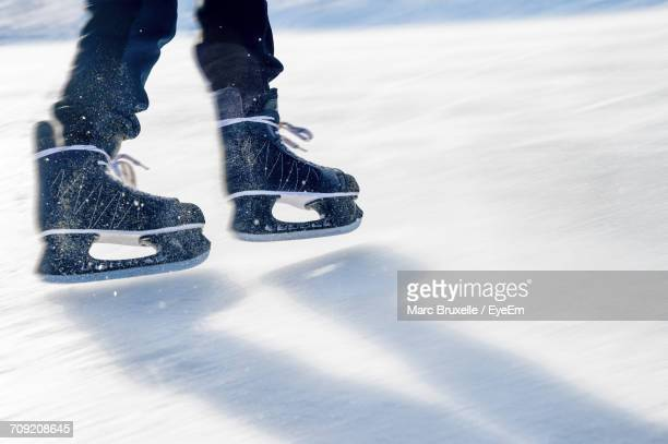 low section of person skating - ice skate stock pictures, royalty-free photos & images