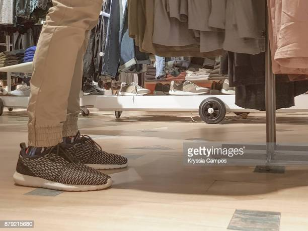 low section of person standing at store - black friday stock photos and pictures