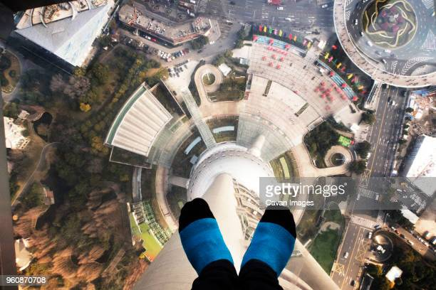 Low section of person standing on glass floor in Oriental Pearl Tower