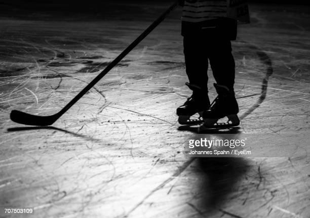 low section of person standing on ice hockey rink - hockey rink stock photos and pictures