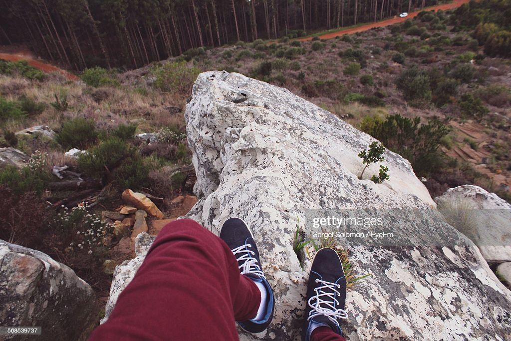 Low Section Of Person Standing On Rock : Stock Photo