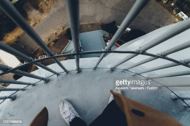 low section of person standing on staircase - koukichi stock pictures, royalty-free photos & images
