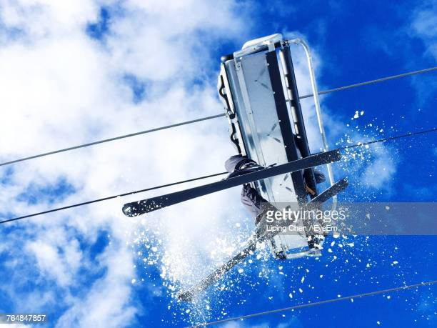 Low Section Of Person Traveling In Ski Lift