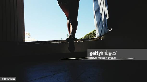 Low Section Of Person Walking On Building Doorway