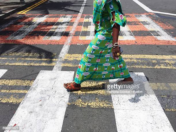 low section of person walking on street - port louis stock photos and pictures