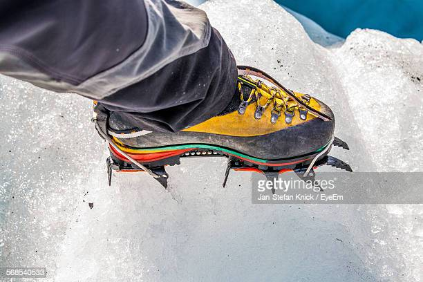 Low Section Of Person Wearing Crampon Shoe