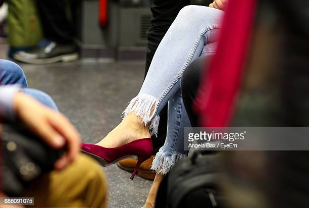 Low Section Of Person Wearing High Heel Shoe