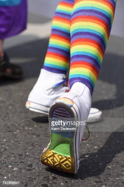 low section of person wearing rainbow colored socks - friedenssymbol stock-fotos und bilder