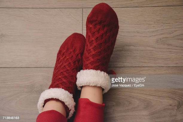 Low Section Of Person Wearing Red Socks During Christmas