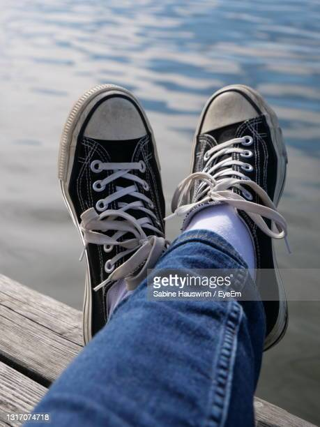 low section of person wearing shoes - sabine hauswirth stock pictures, royalty-free photos & images