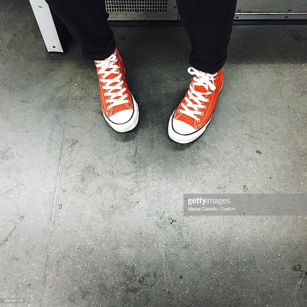Low Section Of Person Wearing Sports Shoes : Foto stock