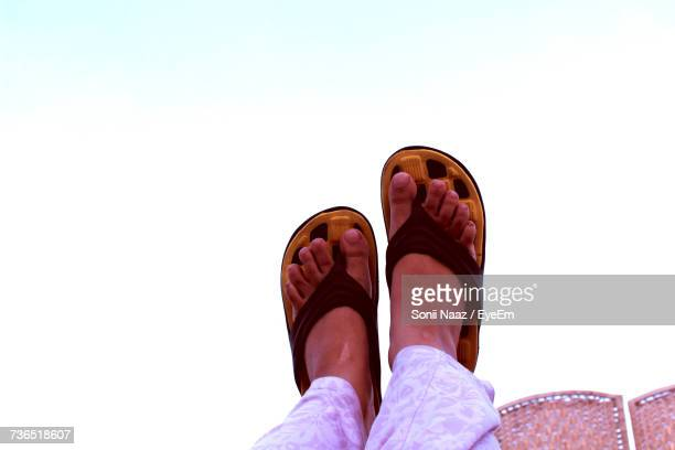 Low Section Of Person With Feet Up Against Sky
