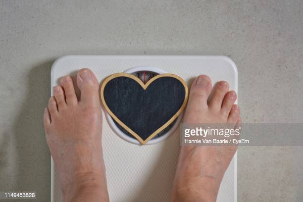 Low Section Of Person With Heart Shape On Weight Scale
