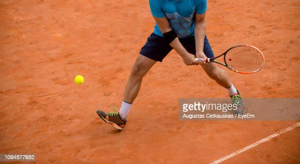 low section of player playing tennis - tennis player stock pictures, royalty-free photos & images